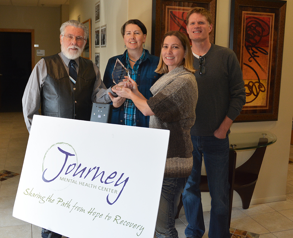 "From left: WiNTiP Managing Consultant David ""Mac"" Macmaster presents the award named in his honor to Kathryn Rindy, Saima Chauhan and Michael Wiltse of Journey Mental Health."