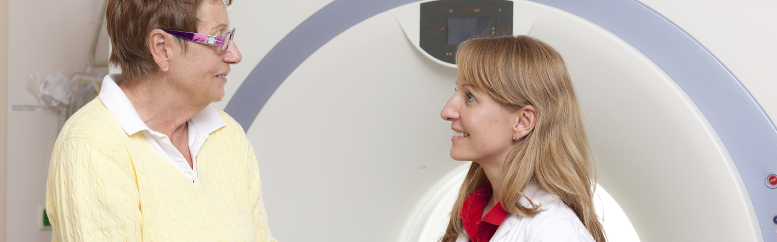 A doctor speaks with an oncology patient