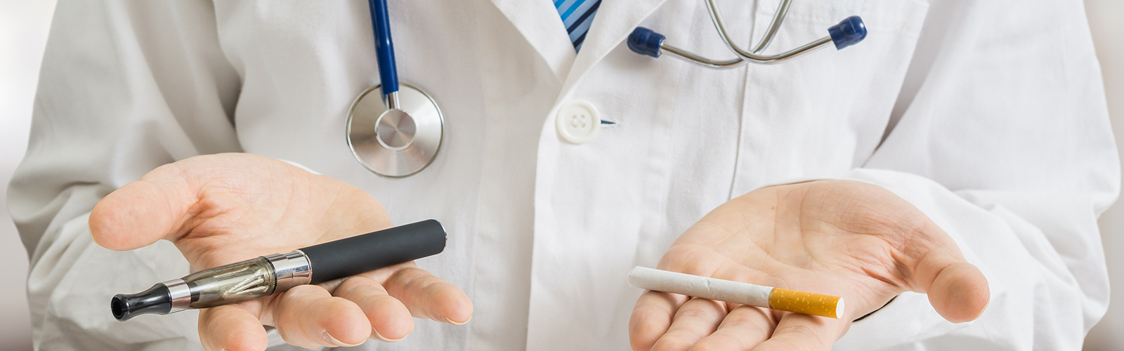 Doctor holds e-cig and cig